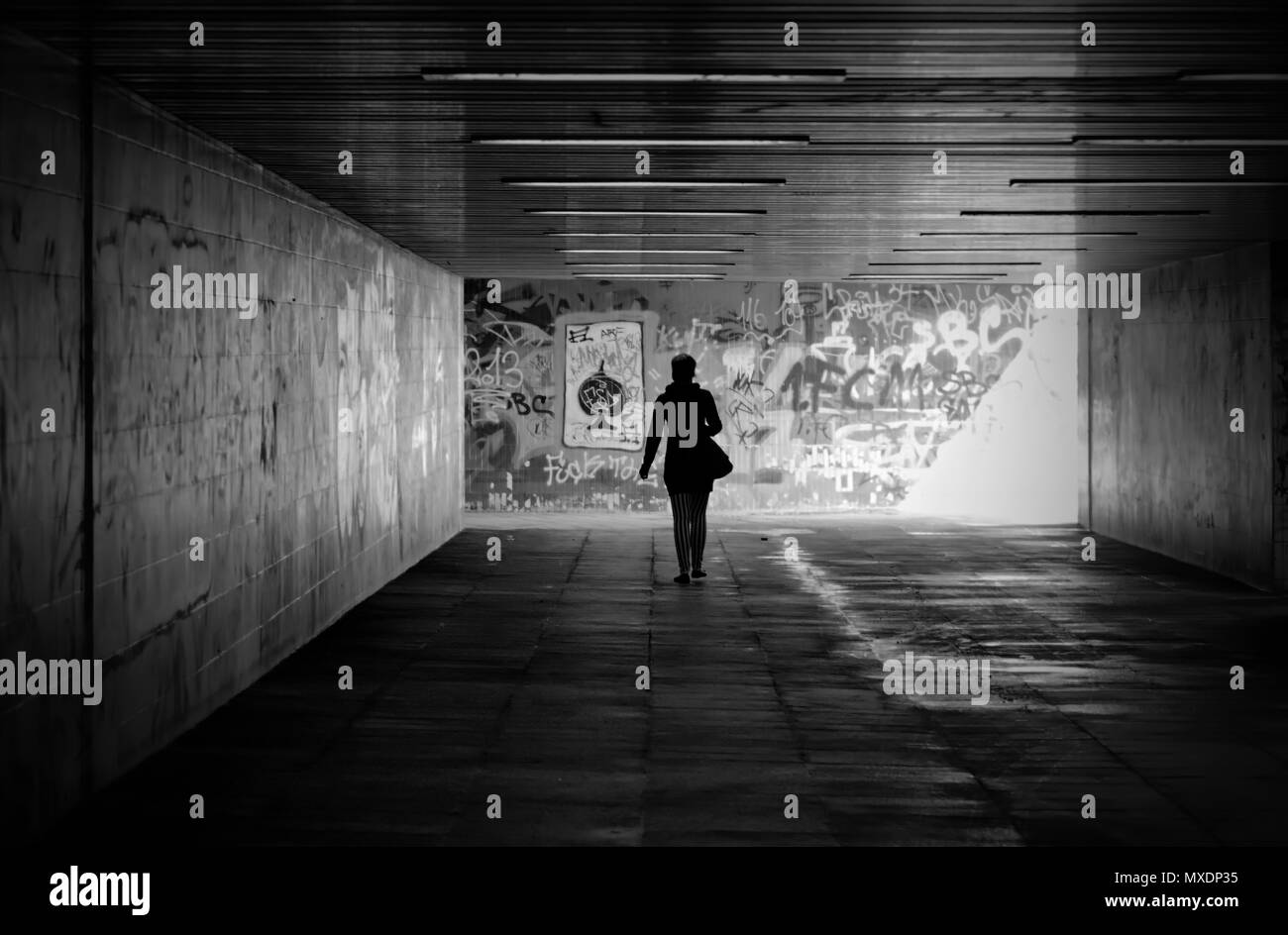 Woman in an underpass - Stock Image
