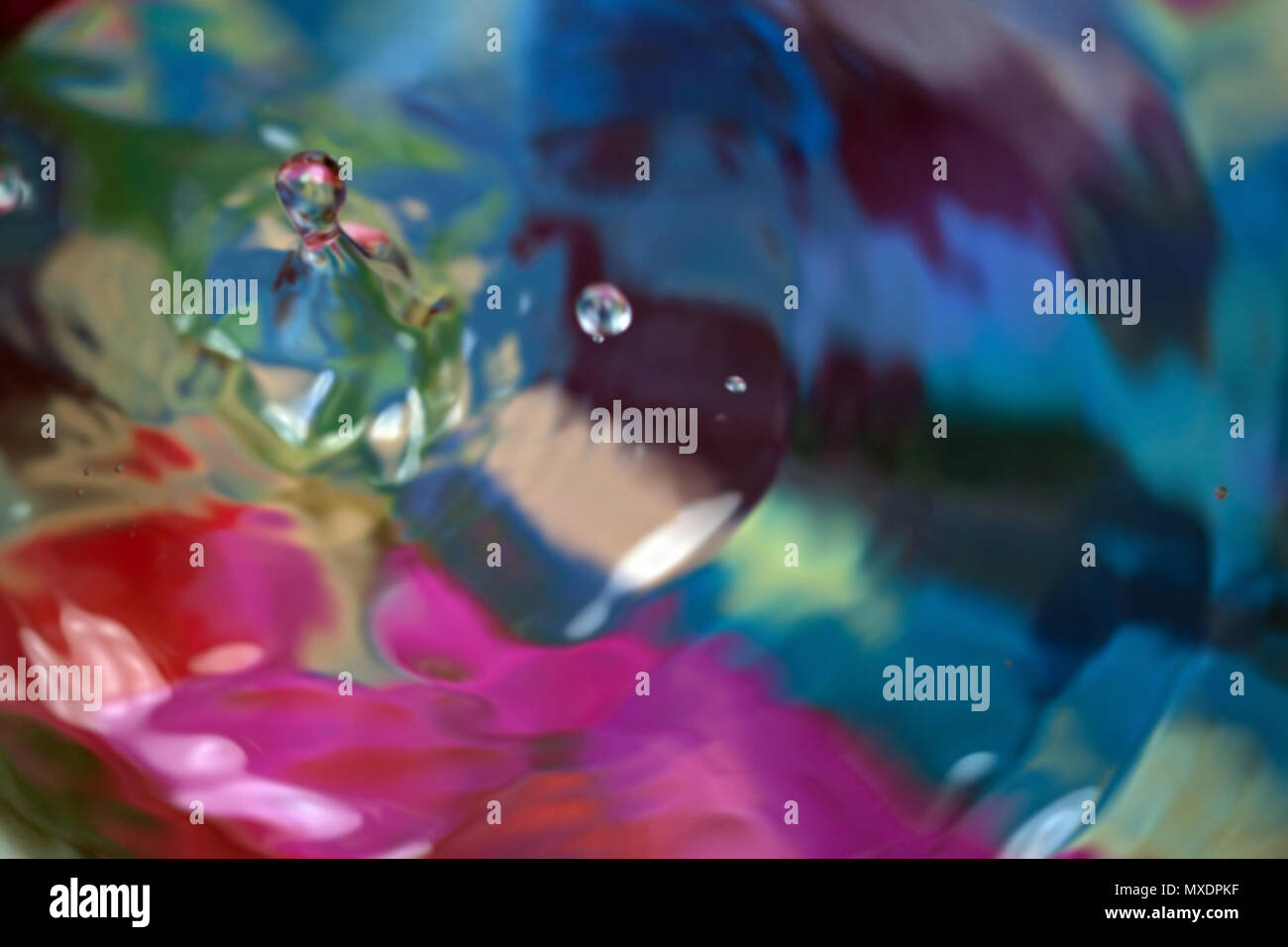 Color motion drop in water, abstraction blurred - Stock Image