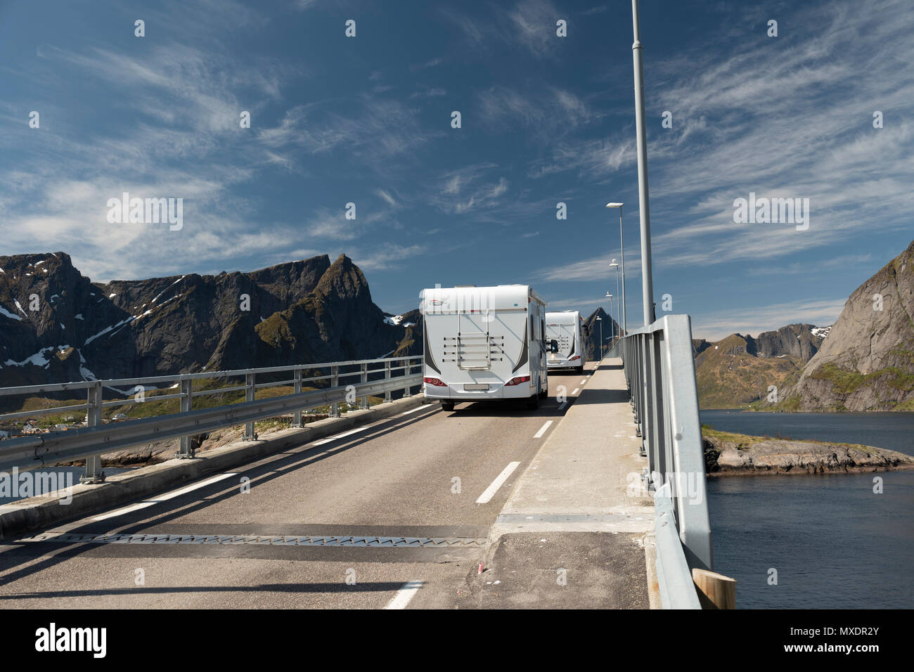Camper vans driving over a bridge at Hamnoy, Lofoten Islands, Norway. Stock Photo