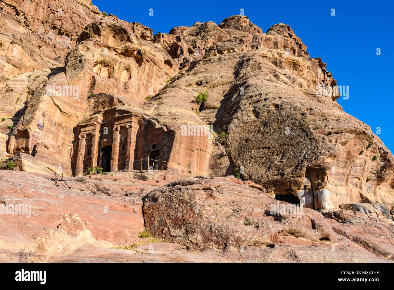 Old tombs at sunset in the Lost City of Petra, Jordan - Stock Image