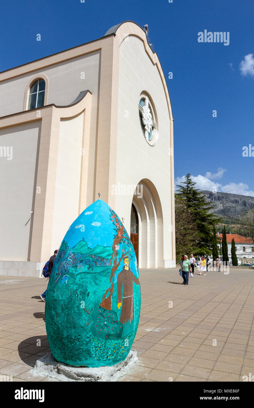 Unusual egg sculpture outside the Church of St. Peter & St. Paul in Mostar, the Federation of Bosnia and Herzegovina. - Stock Image