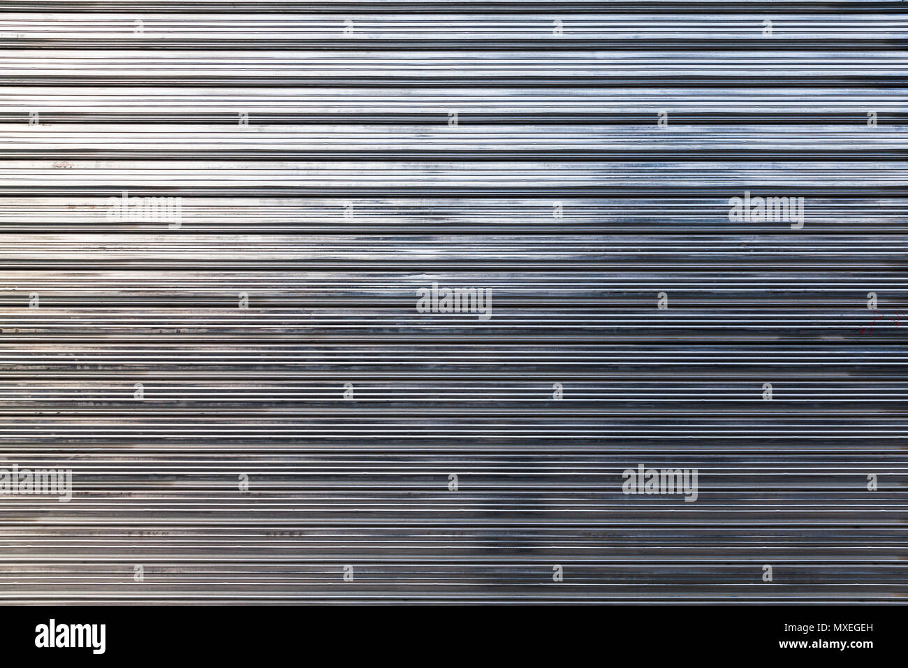 New shining corrugated metal fence, standard industrial wall