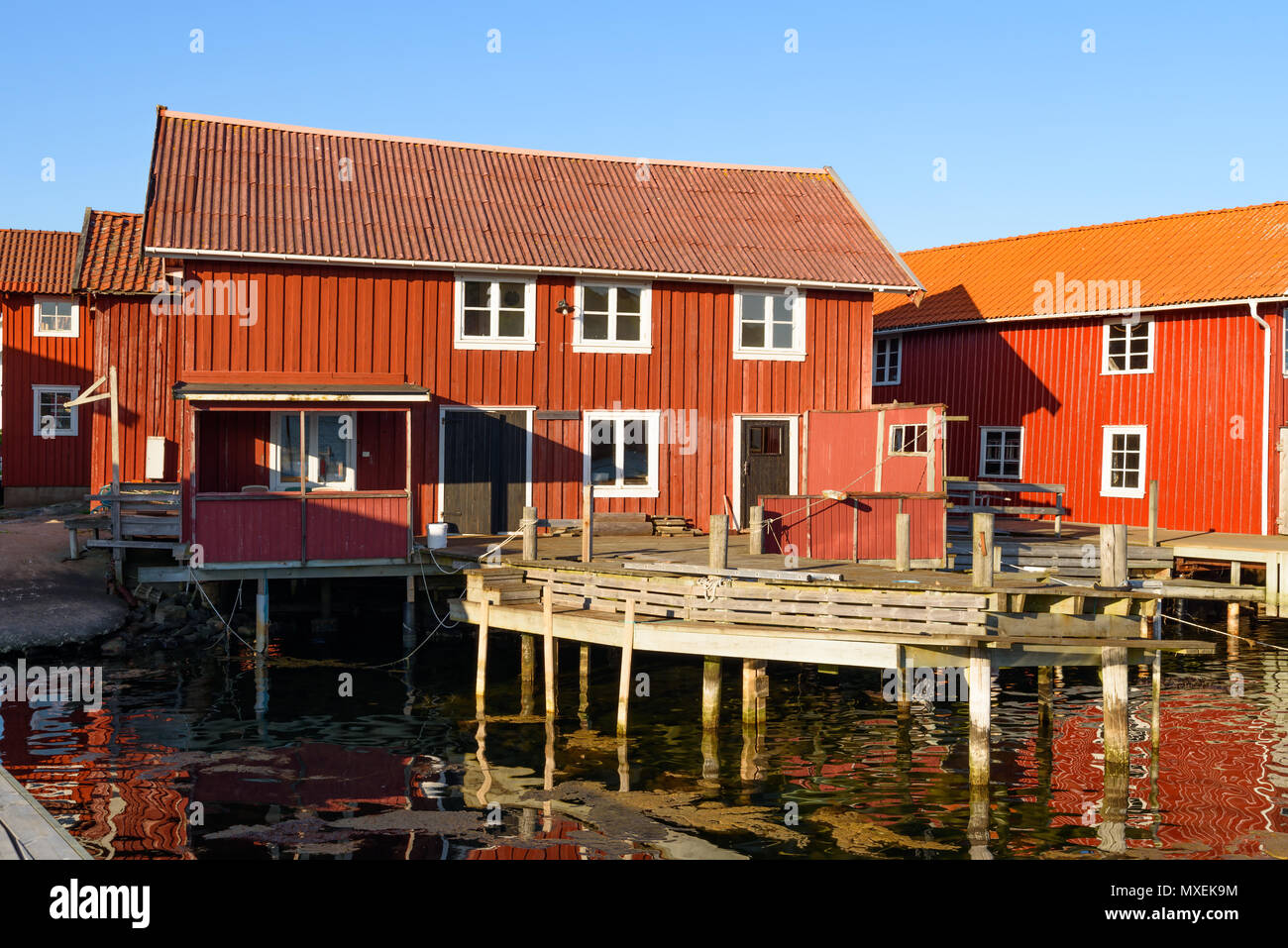 Old wooden buildings in the harbor district of the seaside village of Mollosund on Orust, Sweden. - Stock Image