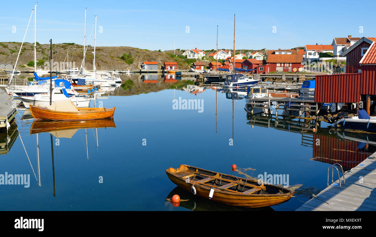 The marina at Halleviksstrand village on Orust, Sweden, on a windless and calm morning. - Stock Image