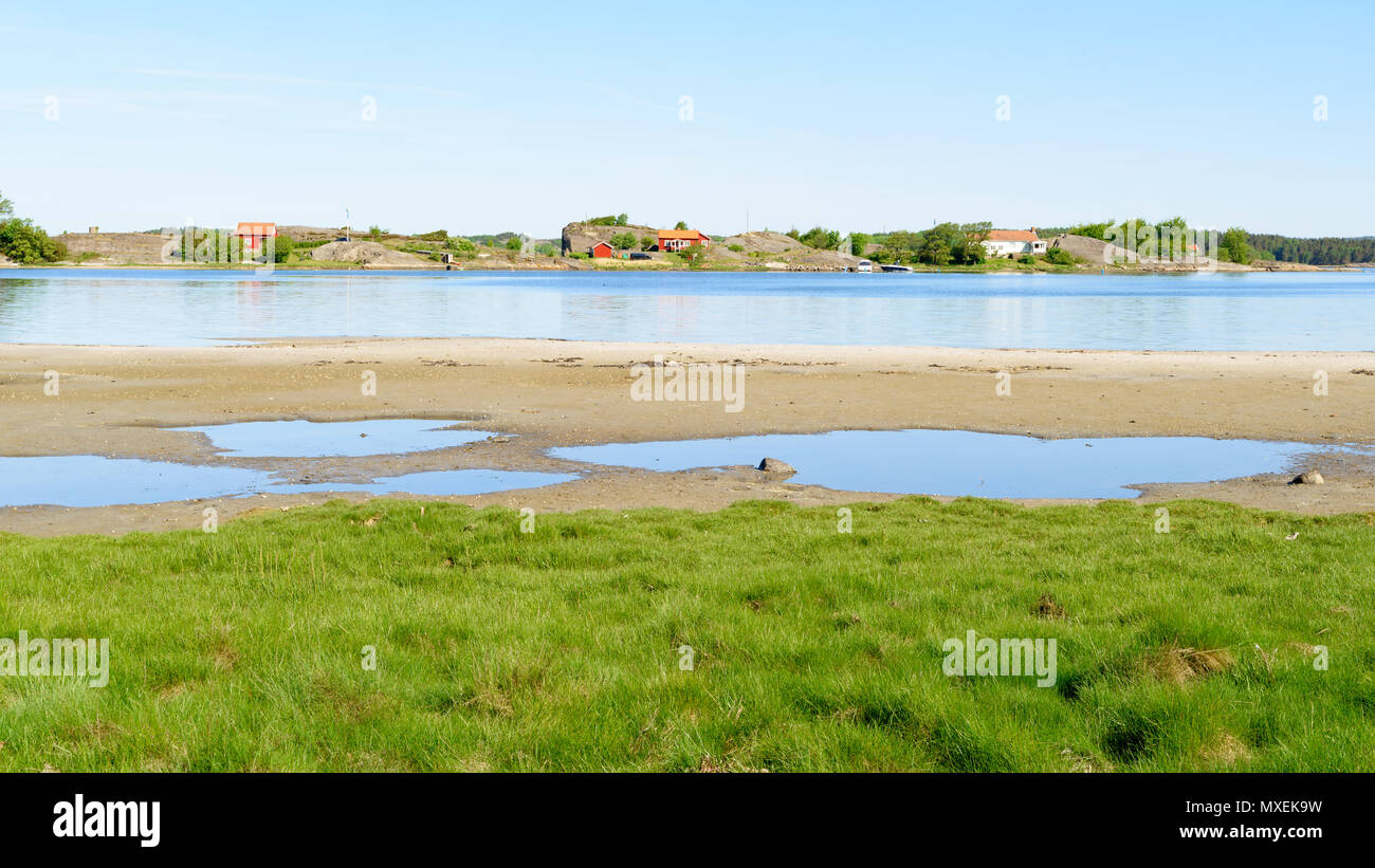 Shallow bay on a sunny morning on Orust, Sweden. - Stock Image