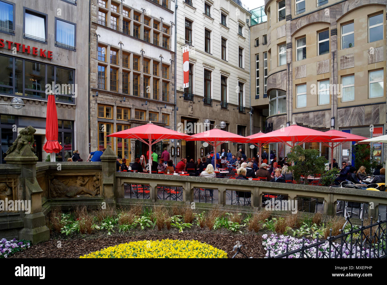 Near Cologne Cathedral in the center of the city are many hidden places.  You can sit outside there and drink your 'Kölsch', a local beer. - Stock Image