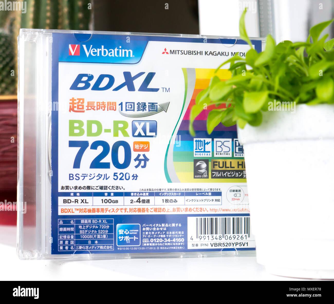 GOMEL, BELARUS - MAY 30, 2018: Mitsubishi (Verbatim) BD-R XL 100GB disc on a variocolor background. - Stock Image