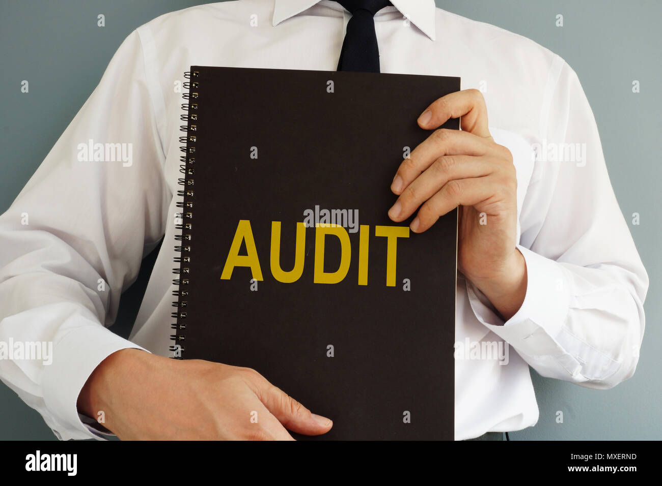 Audit concept. Auditor is holding book. - Stock Image