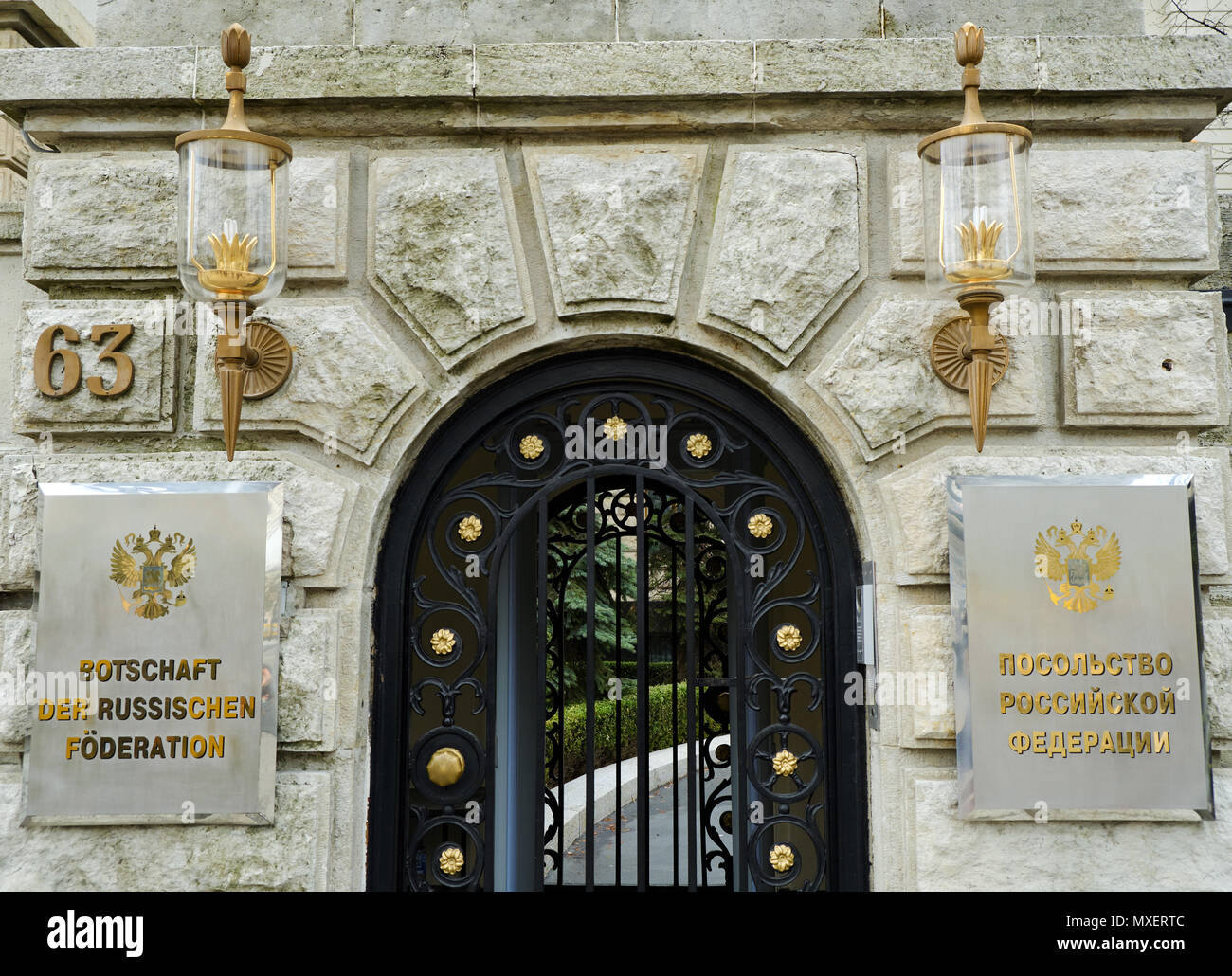 Berlin, Germany - April 14, 2018: Outer gate of Russian Federation Embassy with lamps; nameplates and house number - Stock Image