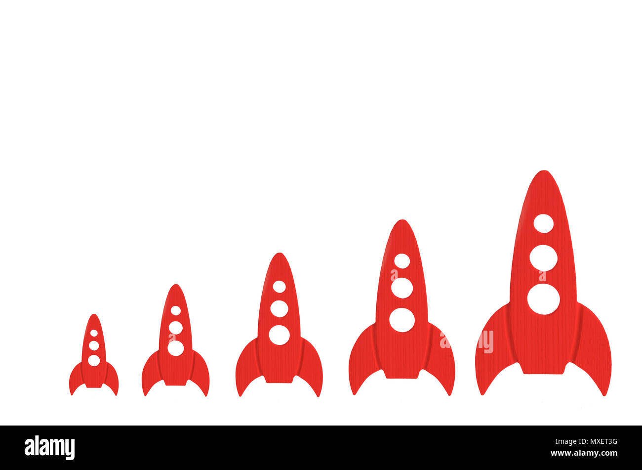 Red rockets are in order of increasing on a white background. The concept of space and technology, travel to the stars and other planets. Space touris - Stock Image