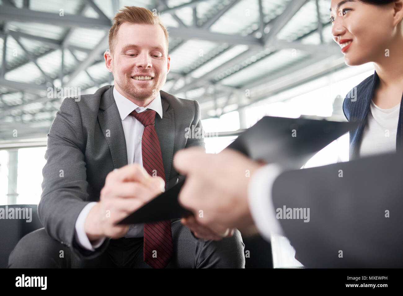 Handsome Entrepreneur Signing Contract - Stock Image