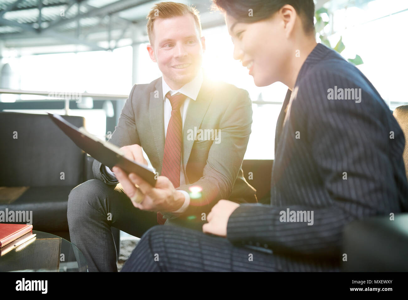 Sharing Creative Ideas with Colleague - Stock Image