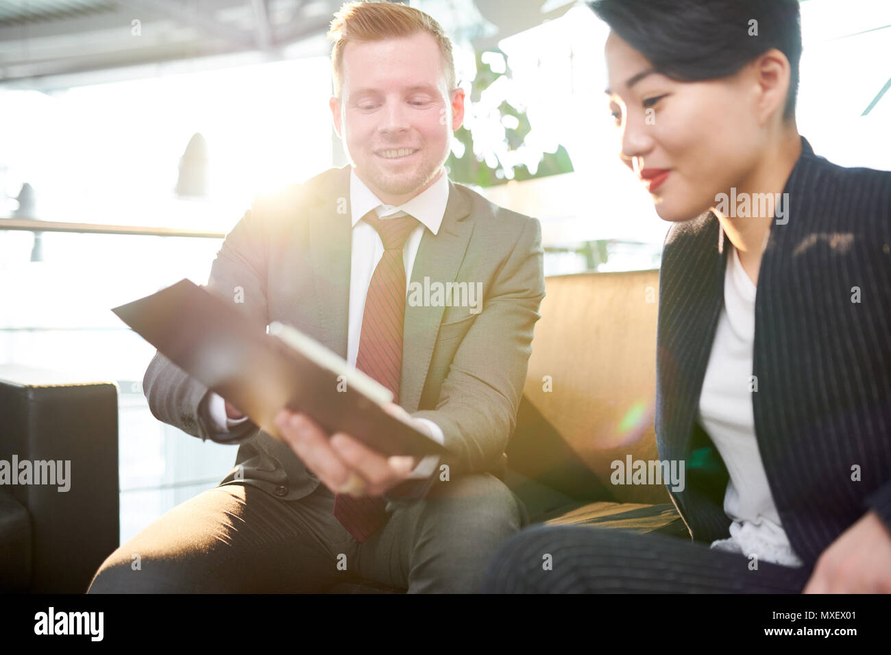 Project Discussion with Male Colleague - Stock Image