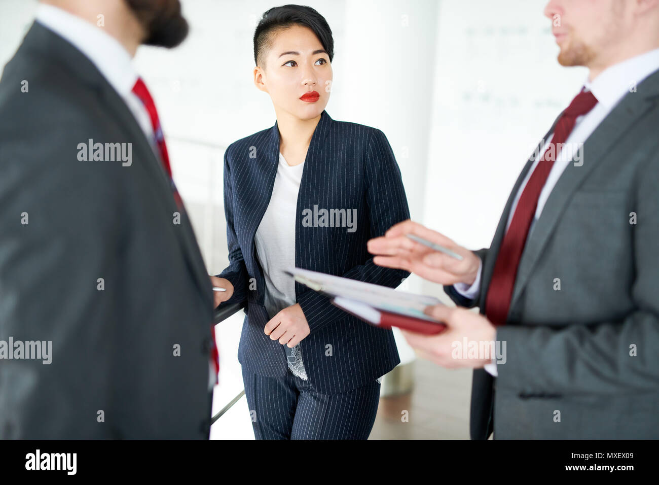 Discussing Joint Project at Office Lobby - Stock Image