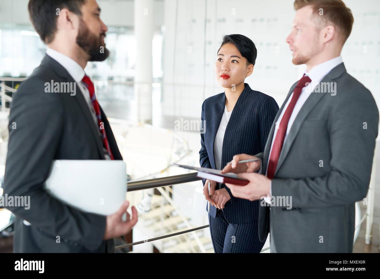 Colleagues Having Informal Working Meeting - Stock Image