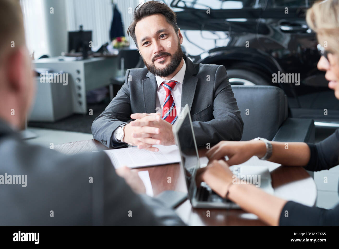 Colleagues Brainstorming on Sales Growth - Stock Image