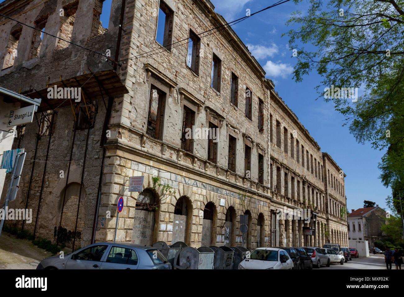 A Bosnian War (Homeland War) damaged building in Mostar, the Federation of Bosnia and Herzegovina. - Stock Image