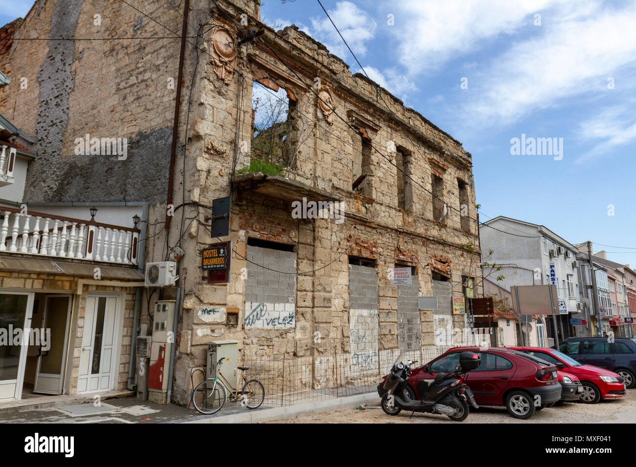 A Bosnian War (Homeland War) damaged building in Mostar, the Federation of Bosnia and Herzegovina. Stock Photo
