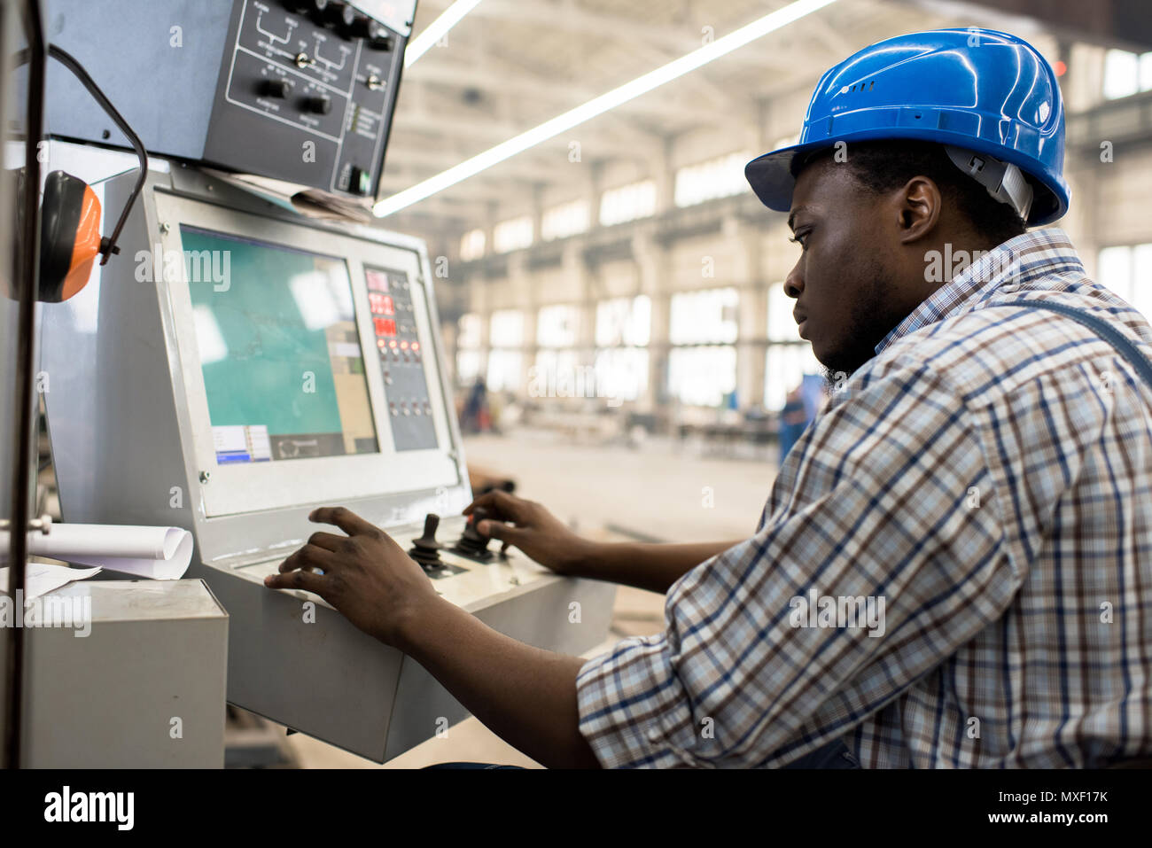 Machine Operator Focused on Work - Stock Image