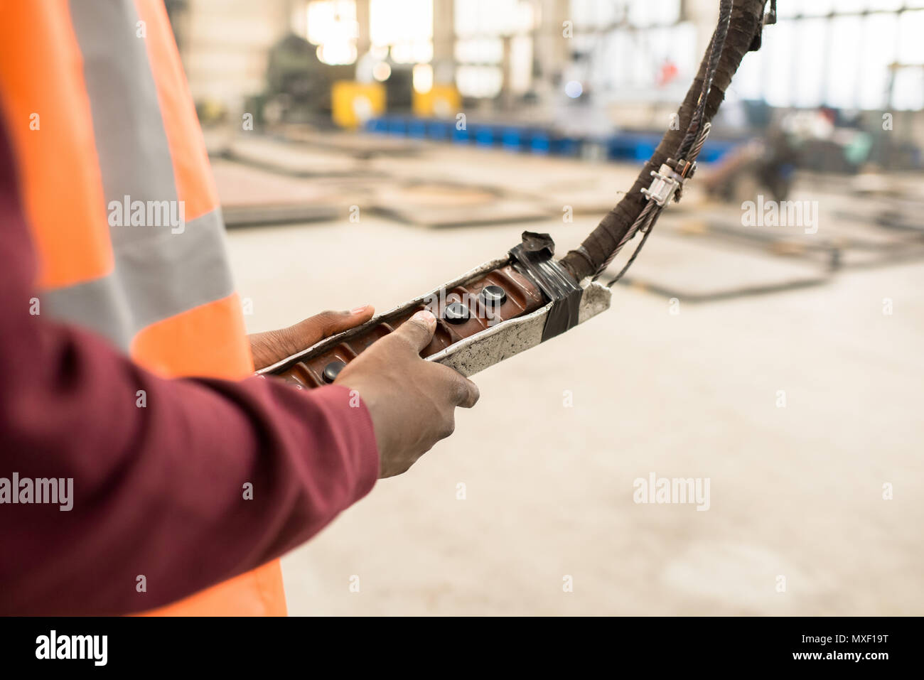 Machine Operator Using Control Panel - Stock Image