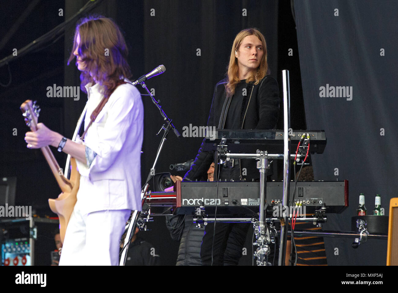 Myles Kellock, keyboards and synthesizers player for indie pop band Blossoms, live onstage. The other band member pictured (on the left) is vocalist Tom Ogden. Blossoms live, Blossoms in concert. - Stock Image