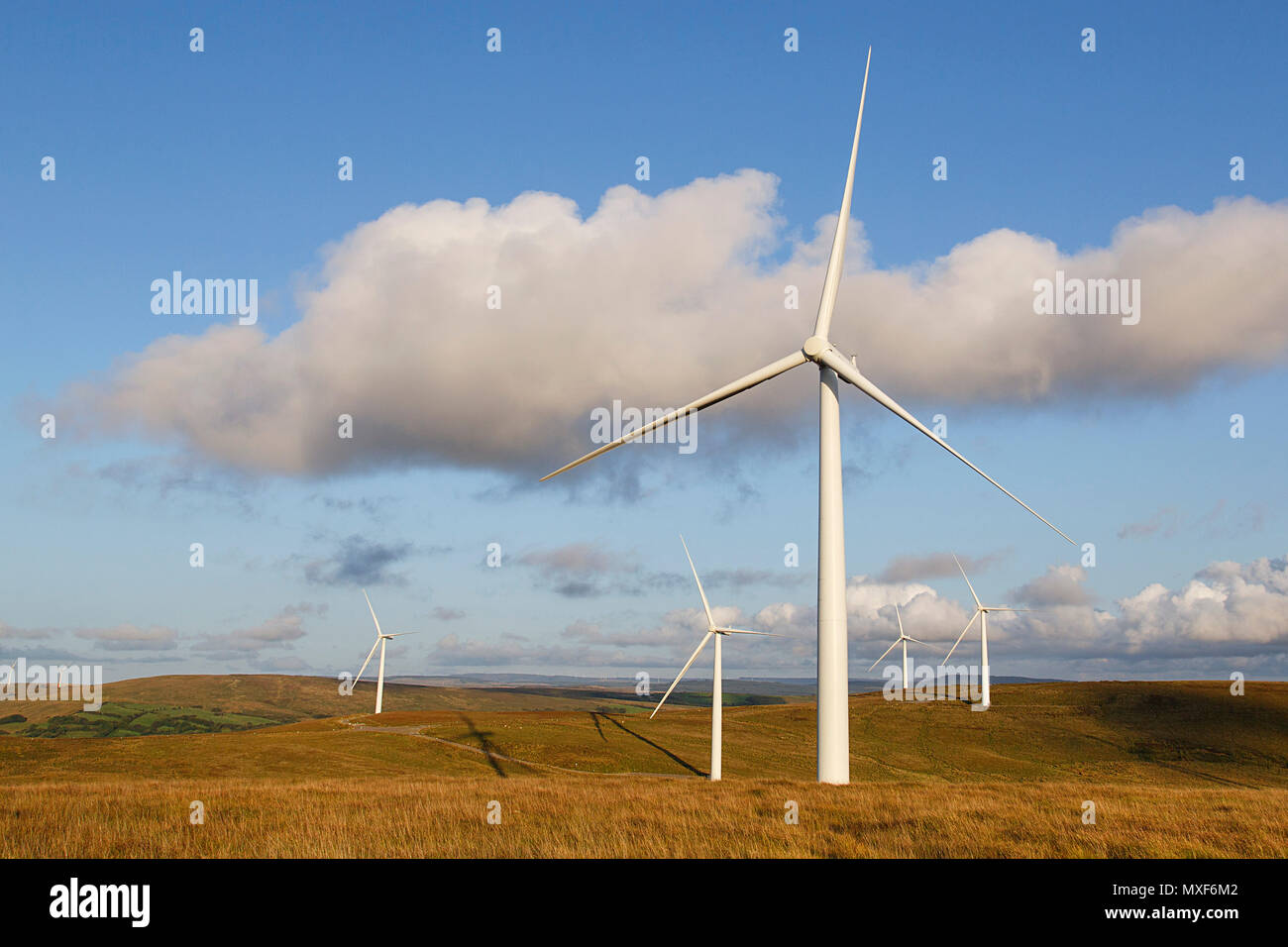 Environmentally friendly power generation wind power turbines in a rural location in Wales. - Stock Image