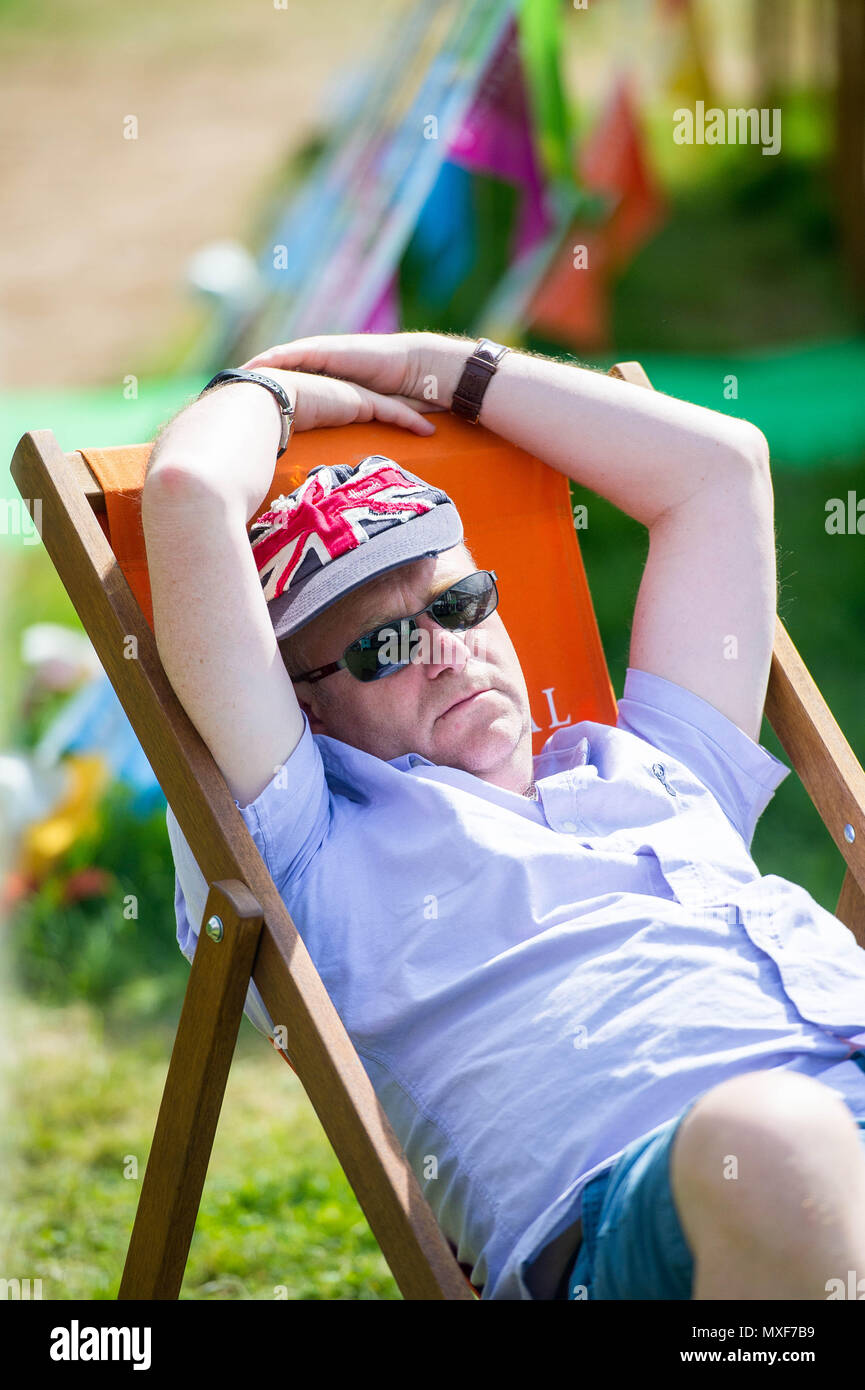 Sunday  03 June 2018  Pictured: A man snoozes in the hot sun at the  festival  Re: The 2018 Hay festival take place at Hay on Wye, Powys, Wales - Stock Image