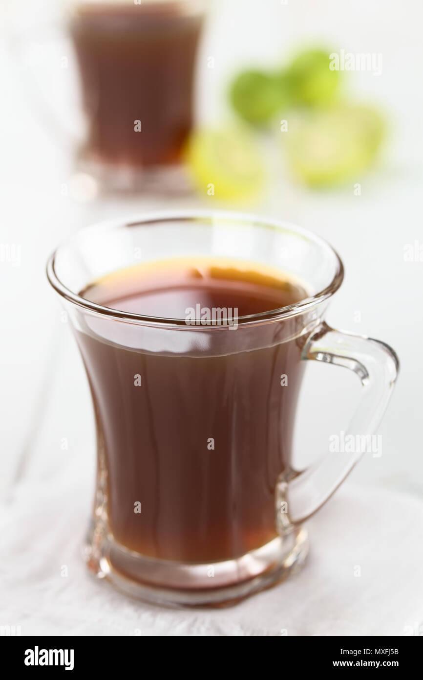 Fresh homemade Aguapanela, Agua de Panela or Aguadulce, a popular Latin American sweet drink made of panela unrefined whole cane sugar boiled in water - Stock Image