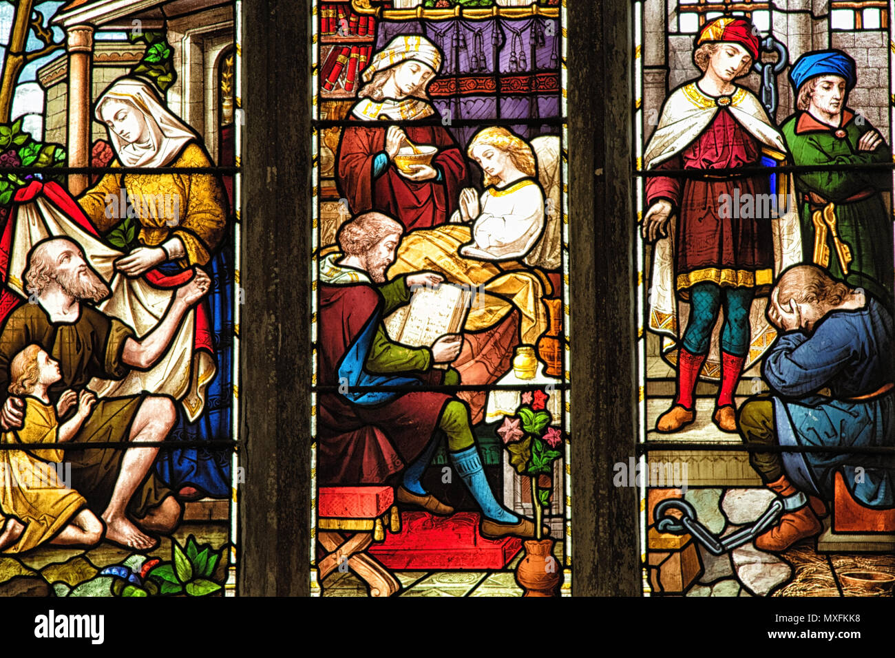 Colourful stained glass windows at All Saints Church,Otley,West Yorkshire,England,UK. - Stock Image