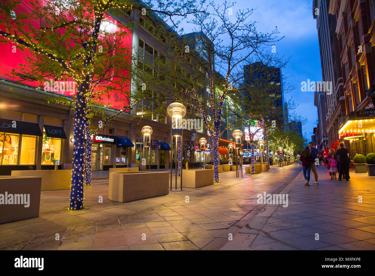 DENVER, COLORADO - MAY 1, 2018: Street scene along the 16th Street Mall in downtown Denver Colorado at night with lights and people in view - Image - Stock Image