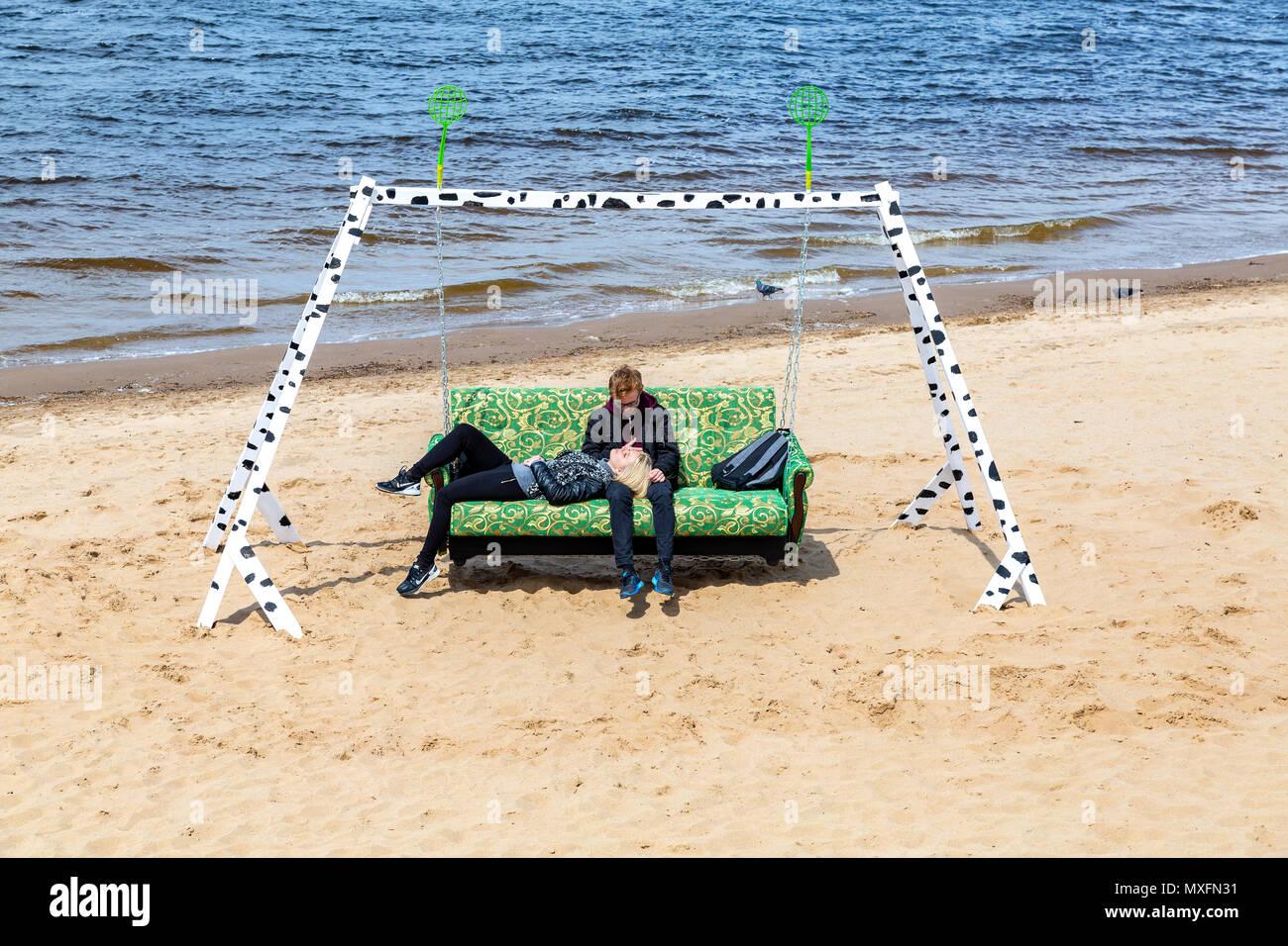 Samara, Russia - June 2, 2018: Art installation as the swing at the sand beach of Volga river. Interregional festival of city embankments 'Volga Fest  - Stock Image