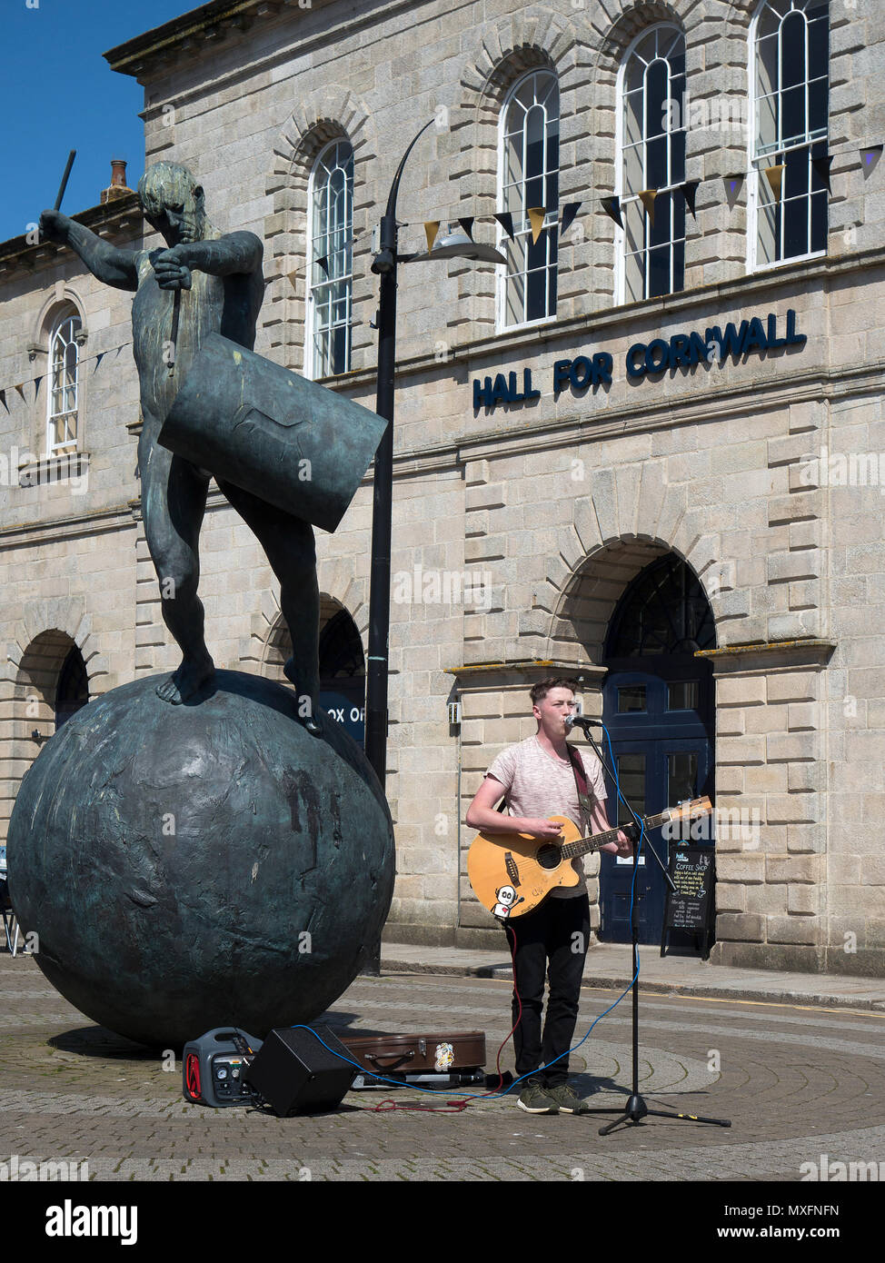young man busking outside the hall for cornwall in truro, cornwall, england, britain, uk, - Stock Image