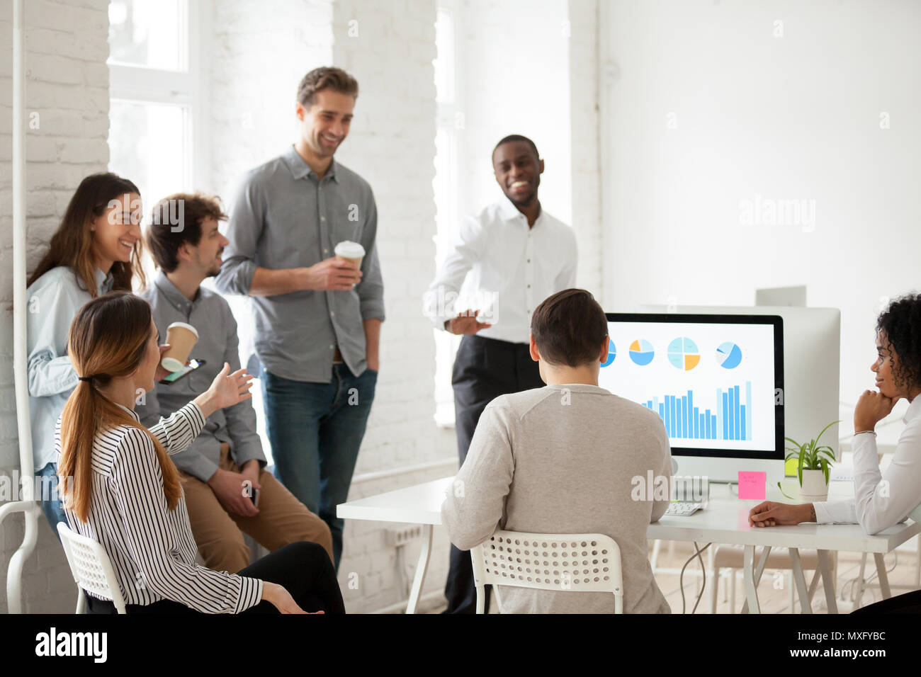Multiracial team having fun during work break - Stock Image