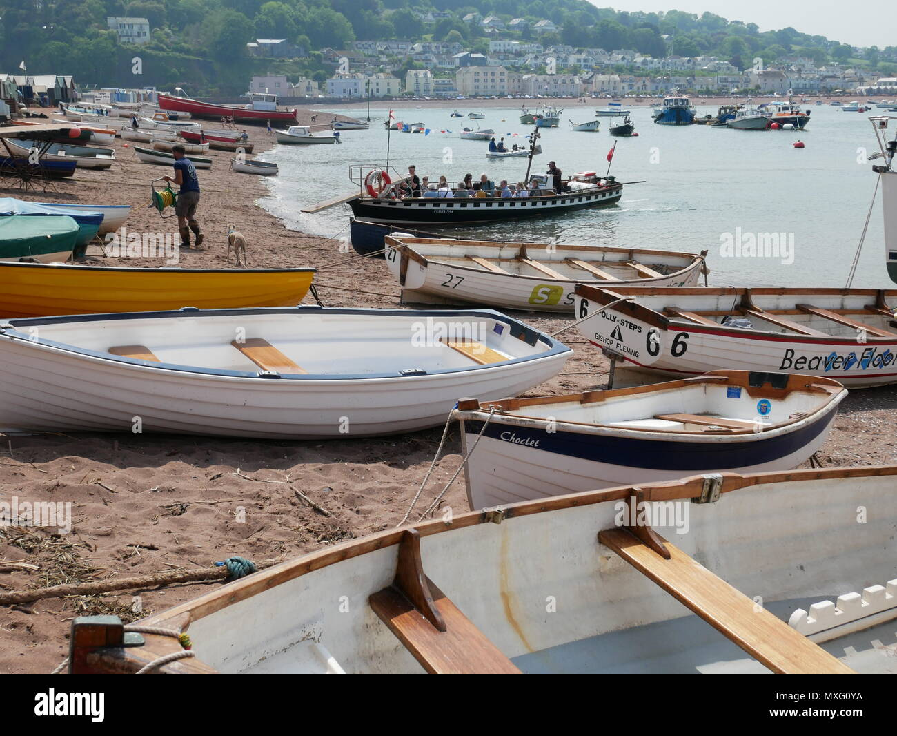 Boats on the beach and the ferry to Shaldon at Teignmouth, Devon, England. Stock Photo
