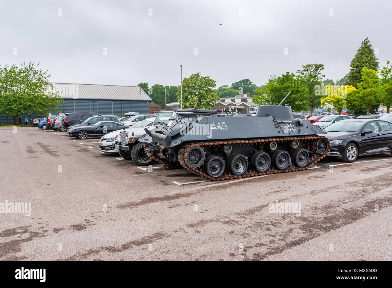 A tank parked in the car park of the tank museum - Stock Image