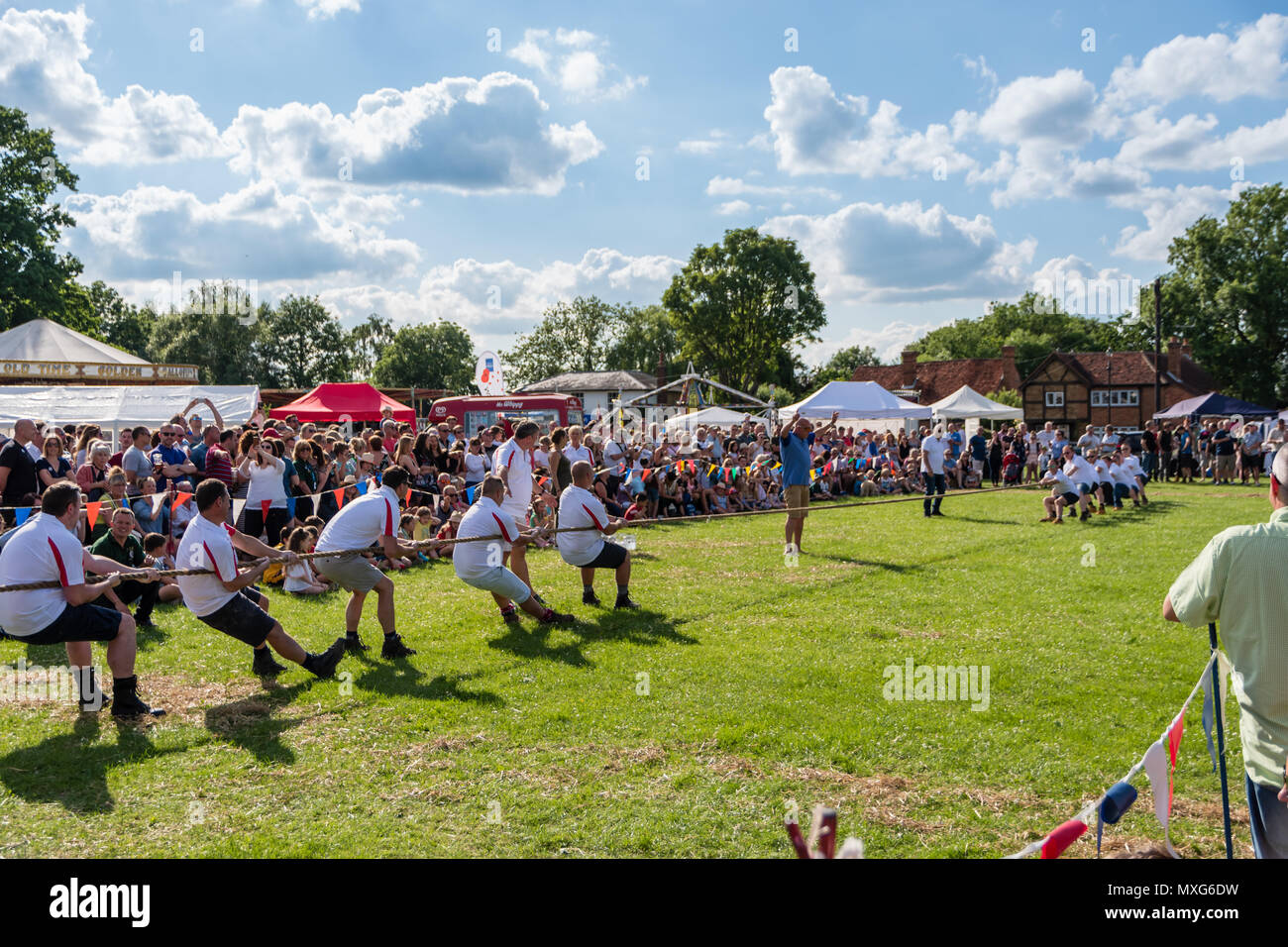 Two teams compete in a Tug of War - Stock Image