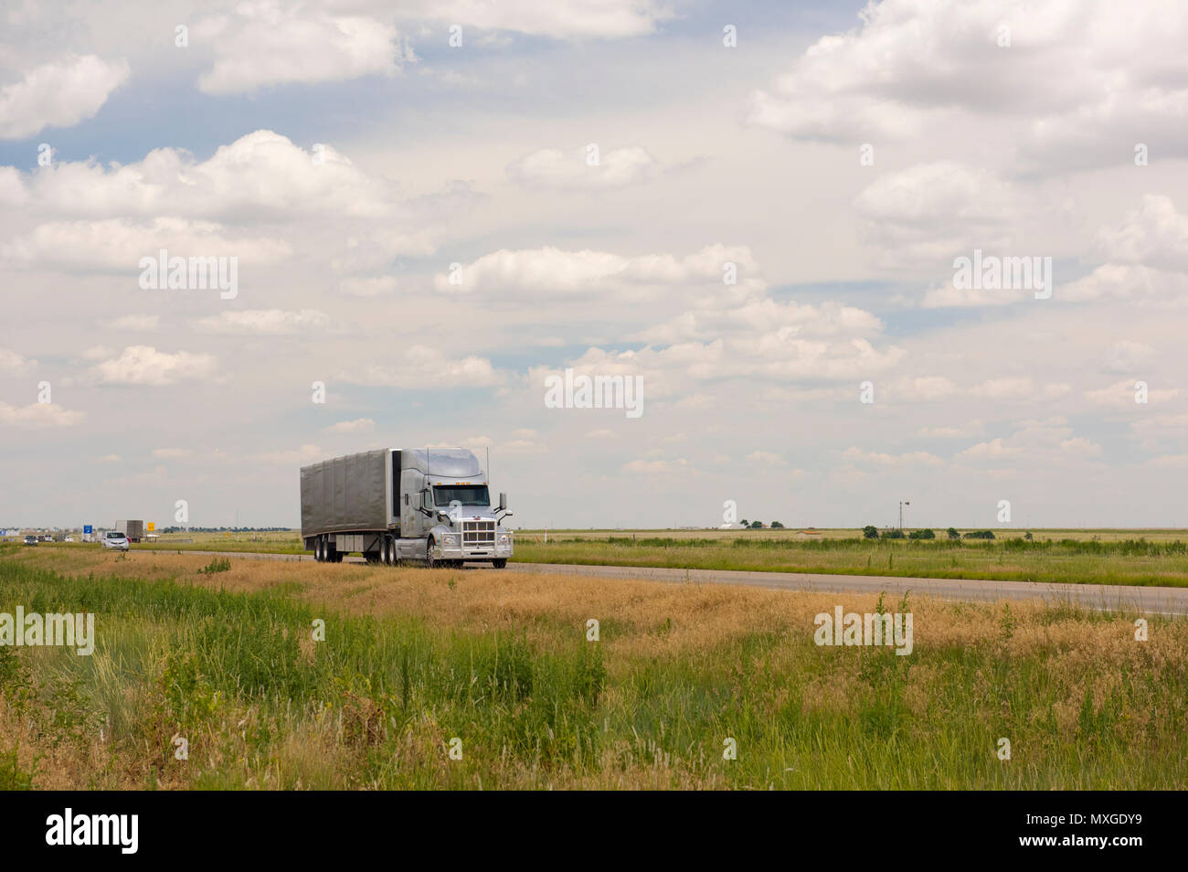 Truck driving on Route 40 in Texas - Stock Image