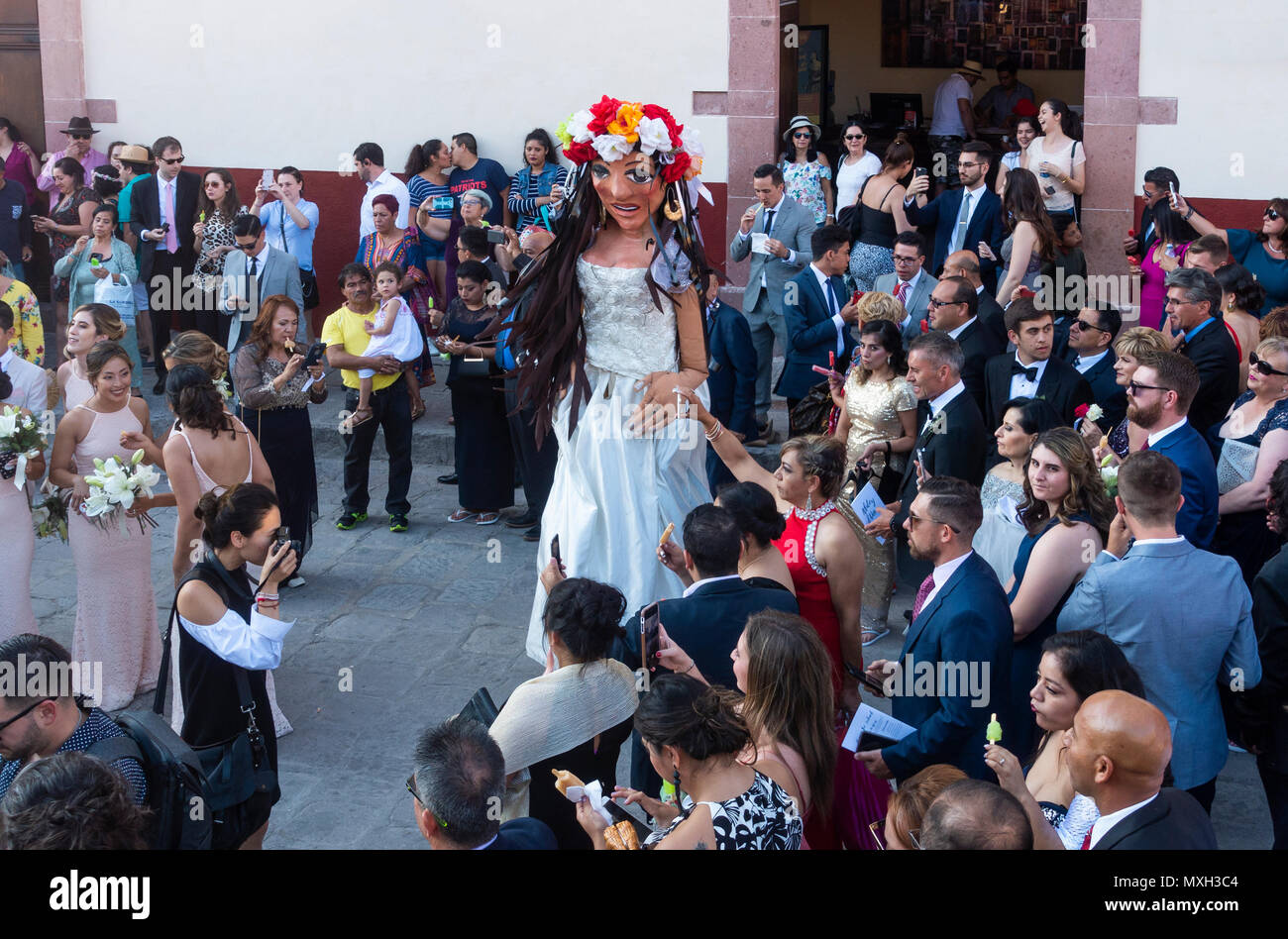 A mojigangas woman dancing to celebrate at a wedding party - Stock Image