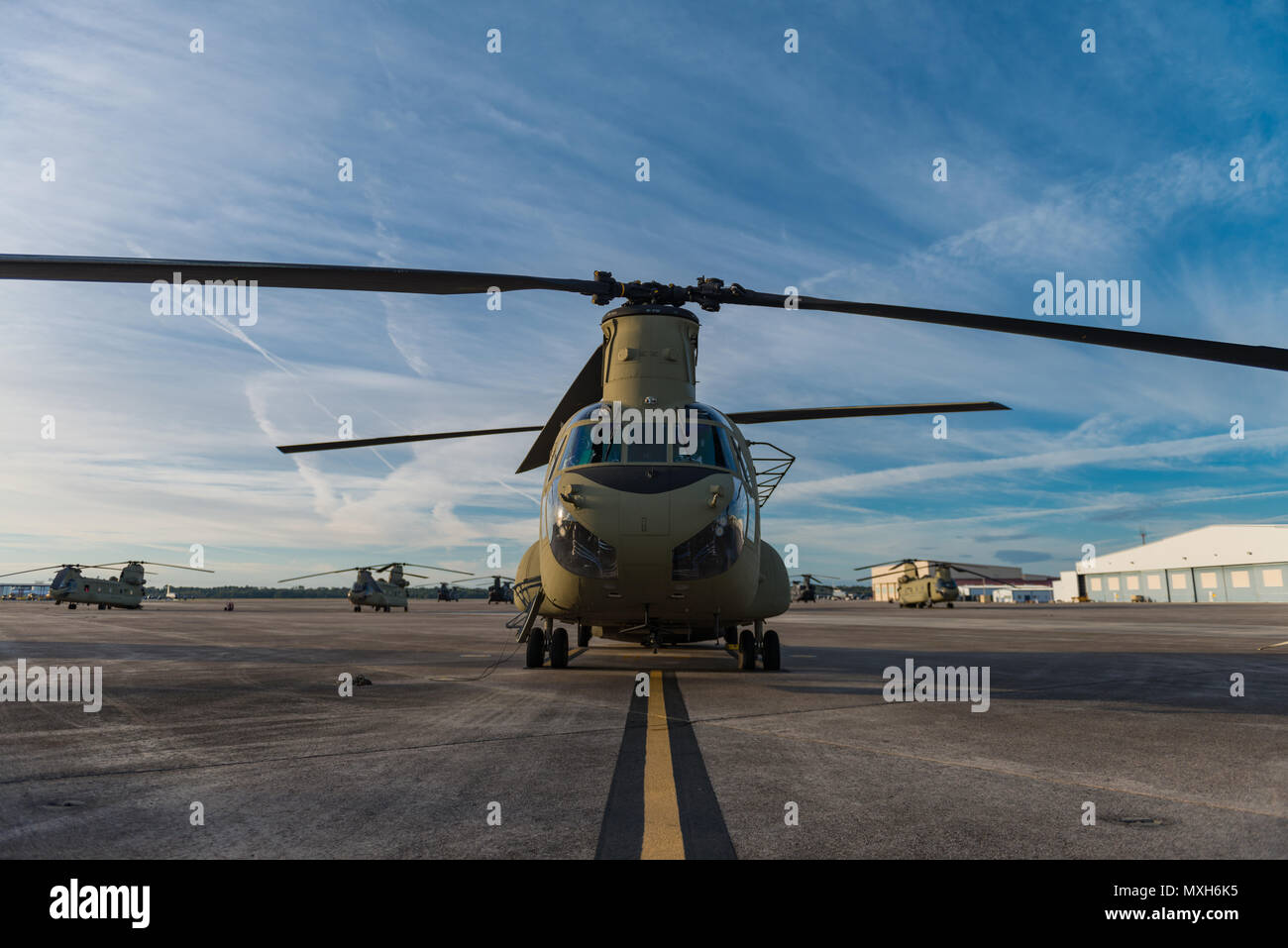 A CH-47 Chinook sits on Hunter Army Airfield prior to a sling load operation, Nov. 6, 2016. (U.S. Army photo by Lt. Col. Brian J. Fickel) - Stock Image