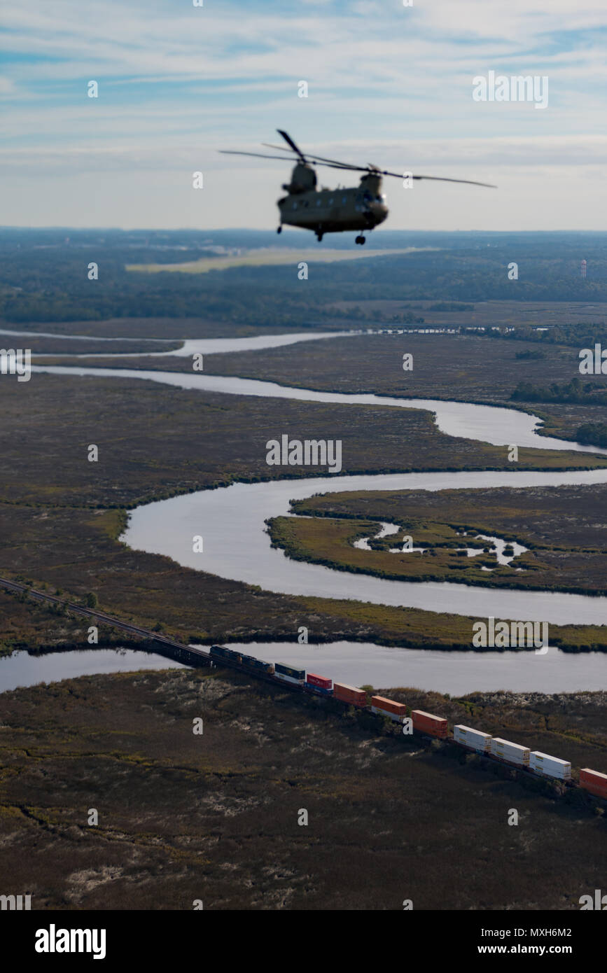 A U.S. Army Chinook maneuvers from Hunter Army Airfield to Fort Stewart during a slingload mission in support of the 3rd Division Artillery, Nov. 6, 2016. (U.S. Army photo by Lt. Col. Brian J. Fickel) Stock Photo