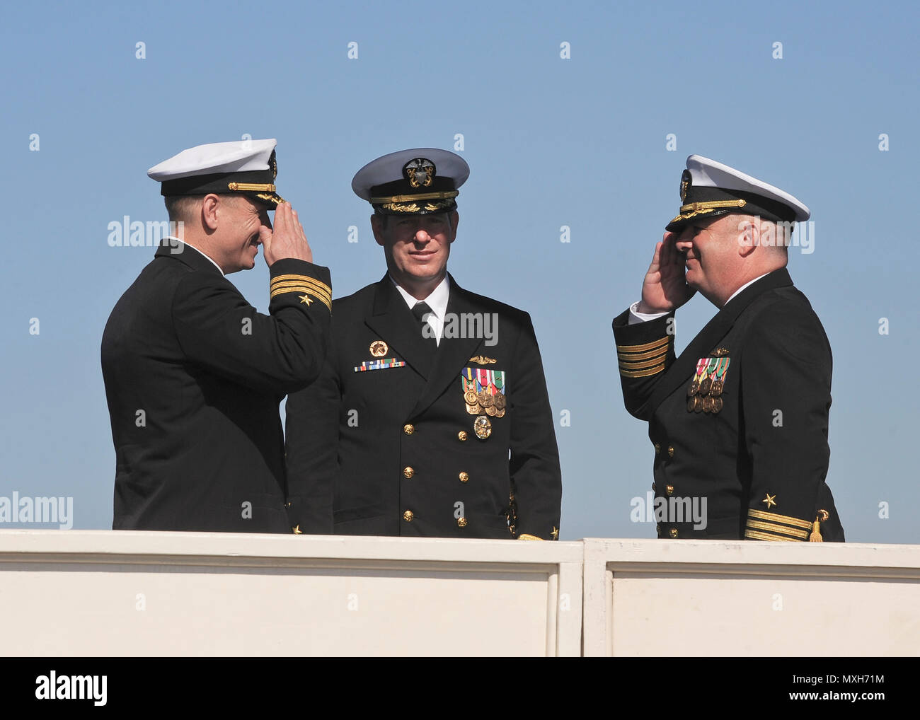 SAN DIEGO (Nov. 4, 2016) – Capt. Daniel Caldwell, right, relieves Cmdr. Jeff Juergens as the commanding officer of the Los Angeles-class fast attack submarine USS San Francisco (SSN 711) during a change of command and farewell ceremony on Naval Base Point Loma, Nov. 4. The San Francisco is scheduled to shift homeports to Norfolk, Va. to begin a two year conversion process to become a moored training ship at the Nuclear Power Training Unit in Charleston, S.C.  (U.S. Navy photo by Petty Officer 1st Class Ronald Gutridge/Released) - Stock Image