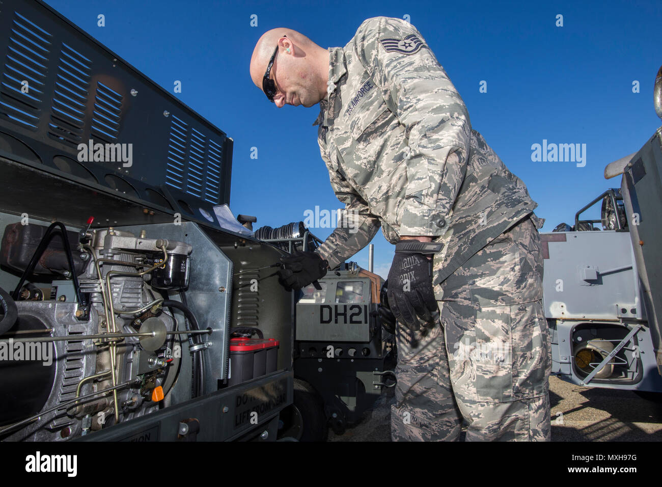 Staff Sgt. Joseph Cox, Aerospace Ground Equipment Technician, 108th Wing, New Jersey Air National Guard, performs service inspections and operations checks of all the equipment at the 108th AGE yard at Joint Base McGuire-Dix-Lakehurst, N.J., Nov. 5, 2016. (U.S. Air National Guard photo by Master Sgt. Mark C. Olsen/Released) - Stock Image