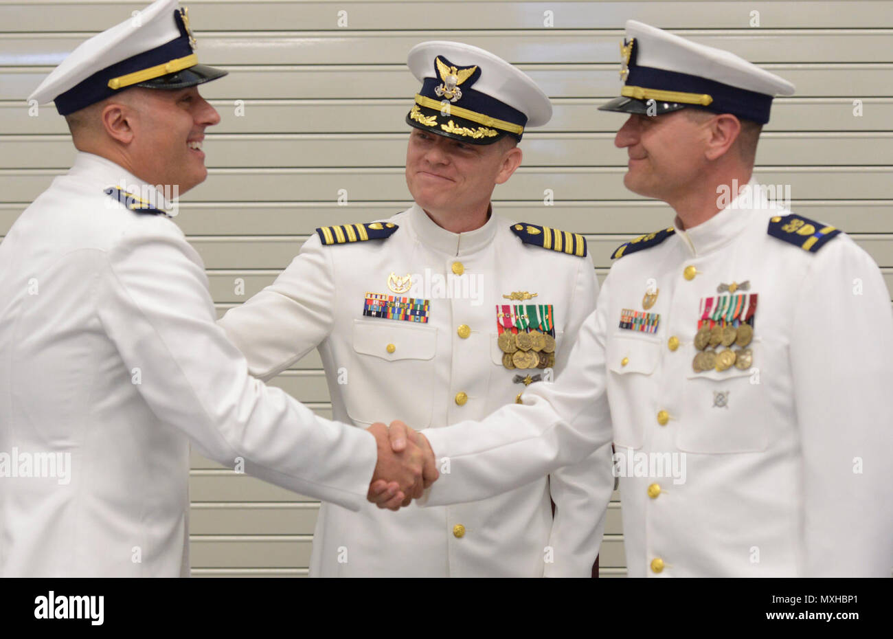 POINT PLEASANT BEACH, N.J. – Chief Warrant Officer Joeseph Carlino takes the command of Coast Guard Station Manasquan Inlet from Chief Warrant Officer Christopher Sparkman during the station's change of command ceremony in Point Pleasant Beach, New Jersey, May 5, 2017. - Stock Image