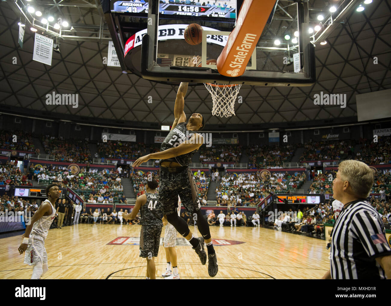 161111-N-AV234-622 (Nov.11, 2016) HONOLULU -- Michigan State Spartan Miles Bridges, jumps for a rebound during the 2016 Armed Forces Classic at Hawaii University's Stan Sheriff Center. The Armed Forces Classic switches venues annually to different military locations around the world. 2016 marks the Fifth Annual Armed Forces Classic and is being held in Hawaii to honor the Navy and the 75th anniversary of the attack on Pearl Harbor. (U.S. Navy photo by Petty Officer 2nd Class Somers Steelman/Released) Stock Photo