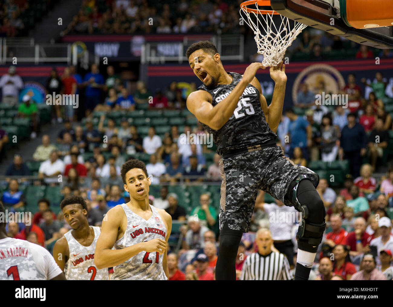 161111-N-AV234-152 (Nov.11, 2016) HONOLULU -- Michigan State Spartan Kenny Goins slam dunks a basket during the 2016 Armed Forces Classic at Hawaii University's Stan Sheriff Center. The Armed Forces Classic switches venues annually to different military locations around the world. 2016 marks the Fifth Annual Armed Forces Classic and is being held in Hawaii to honor the Navy and the 75th anniversary of the attack on Pearl Harbor. (U.S. Navy photo by Petty Officer 2nd Class Somers Steelman/Released) Stock Photo