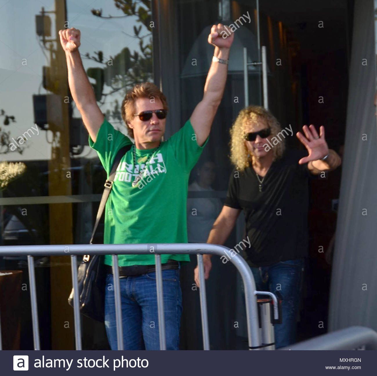 Jon bon jovi and david bryan the rock star raised his arms to greet the rock star raised his arms to greet fans outside his rio de janeiro hotel shortly after being seen on the phone at his balcony m4hsunfo