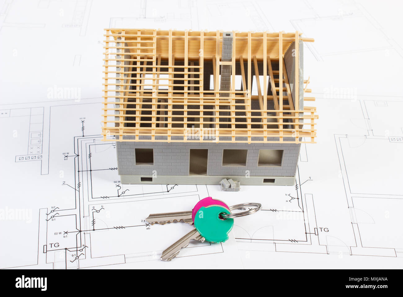 electrical plan new home small house under construction and home keys lying on electrical  small house under construction and home