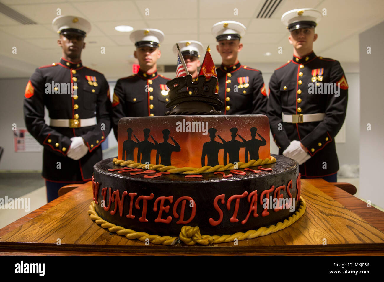 Marines Pose Behind A Marine Corps Birthday Cake During The