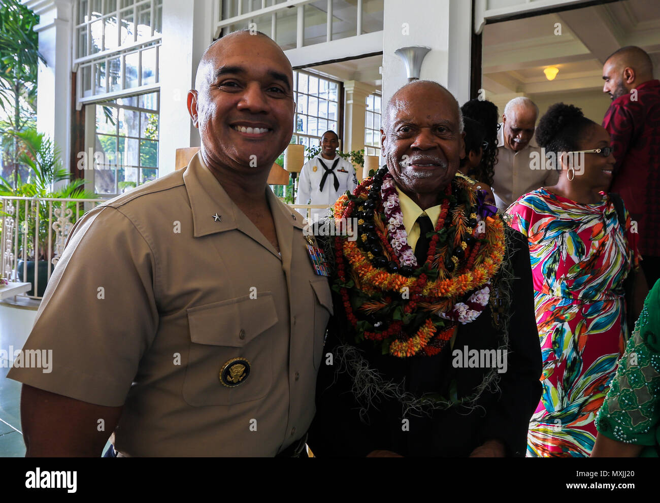 U.S. Marine Brig. Gen. Brian W. Cavanaugh, deputy commander of U.S. Marine Corps Forces, Pacific, and Dr. Ernest James Harris, Jr. stand together after a Congressional Gold Medal presentation in Honolulu Nov. 12, 2016. Harris was awarded his Congressional Gold Medal for his service as a Montford Point Marine. (U.S. Marine Corps photo by Cpl. Wesley Timm) - Stock Image