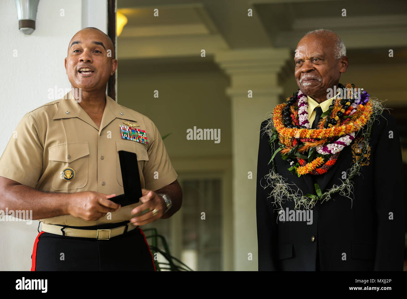 U.S. Marine Corps Brig. Gen. Brian W. Cavanaugh, deputy commander of U.S. Marine Corps Forces, Pacific, presents the Congressional Gold Medal to Dr. Ernest James Harris, Jr. in Honolulu, Hawaii, Nov. 12, 2016. Harris was awarded his Congressional Gold Medal for his service as a Montford Point Marine. (U.S. Marine Corps photo by Cpl. Wesley Timm) - Stock Image